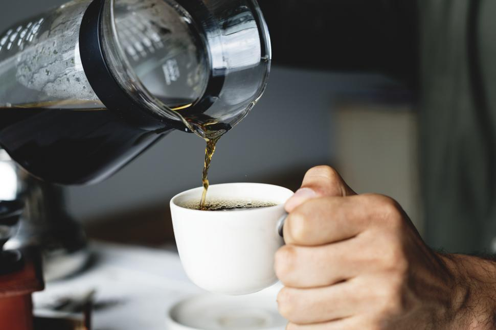 Download Free Stock Photo of Close up of drip coffee being poured into a cup
