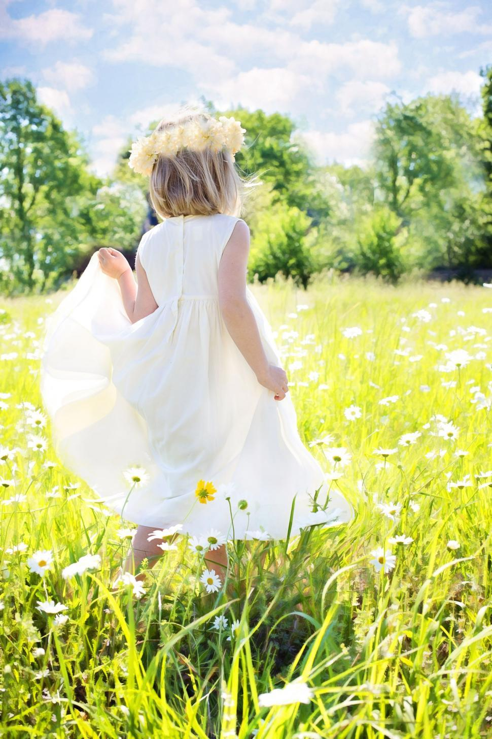 Download Free Stock Photo of Little Girl in White Daisy Flower Field
