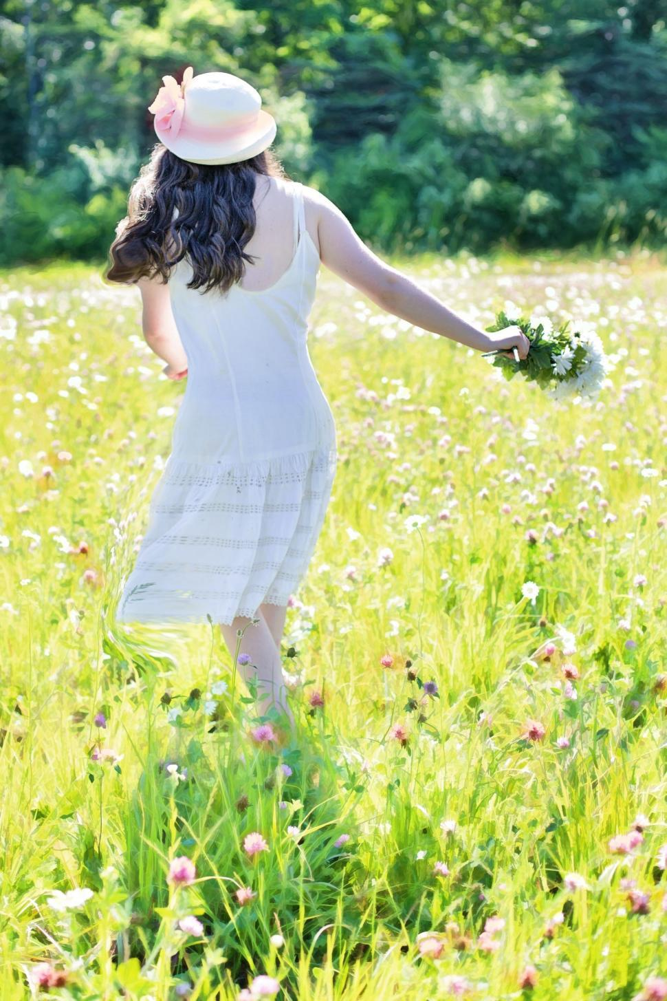 Download Free Stock Photo of Back View of Woman With Hat in Flower Field