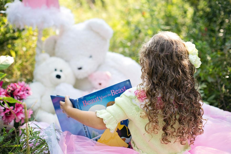 Download Free Stock Photo of Little Girl with book and Teddy Bears in the meadow