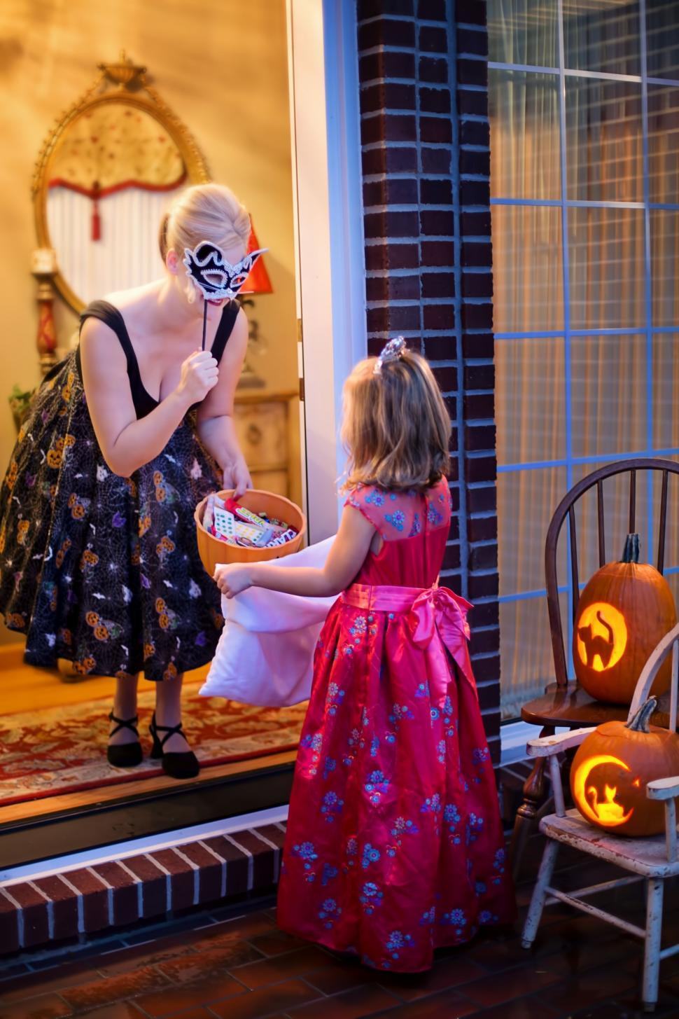 Download Free Stock Photo of Woman and Little Girl in Halloween Costumes