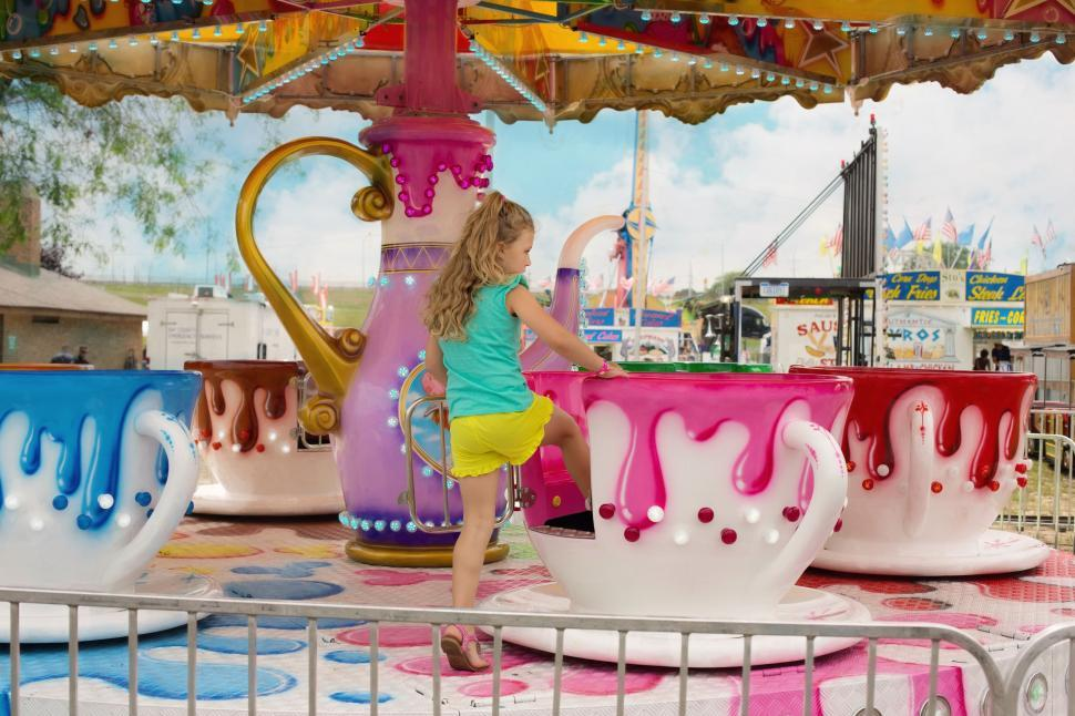 Download Free Stock Photo of Little Girl and tea cup ride
