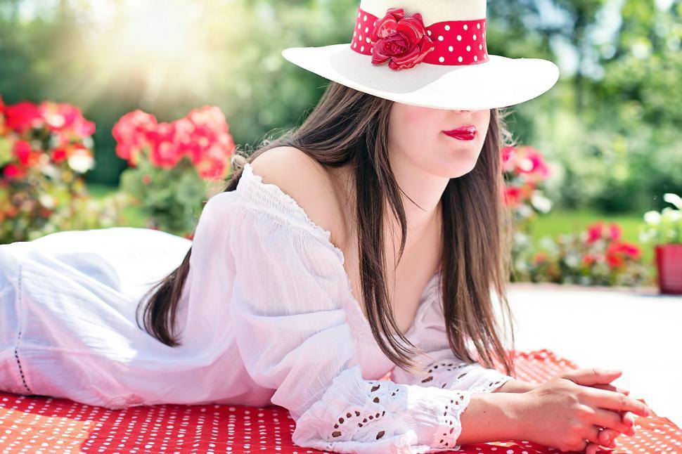 Download Free Stock Photo of Woman in hat with red polka dot ribbon bow