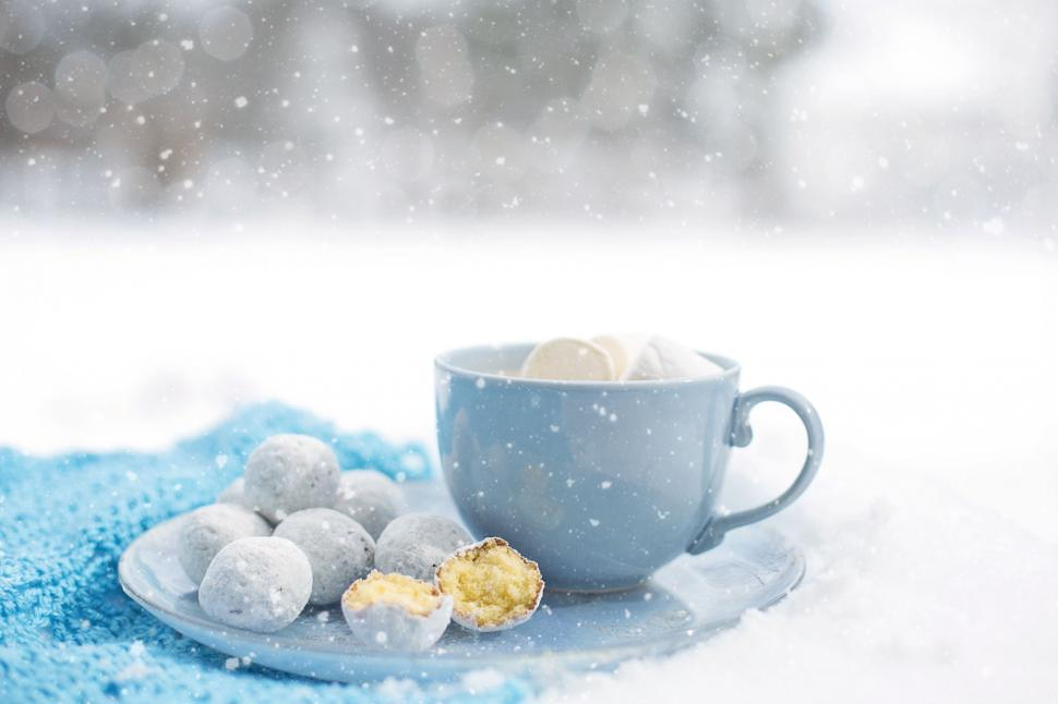 Download Free Stock Photo of Coffee and doughnut holes in snow