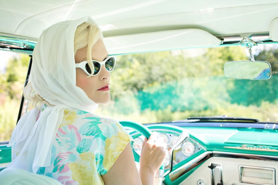 Download Free Stock Photo of Stylish Blonde Woman in Retro Car - Looking Back