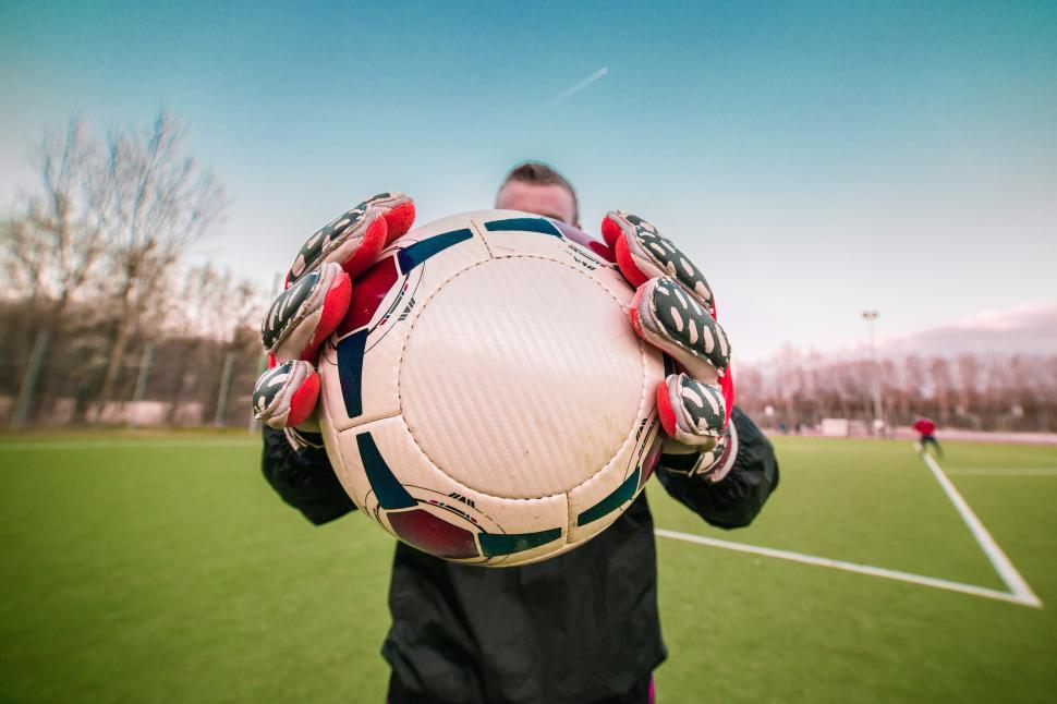 Download Free Stock Photo of Goalkeeper holding and showing football to the camera