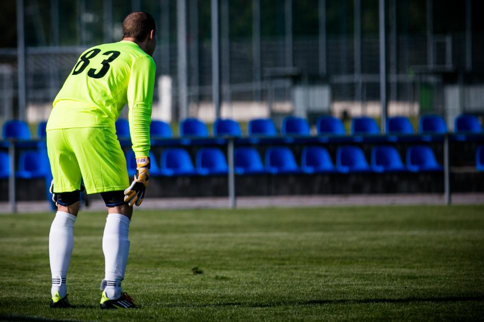 Download Free Stock Photo of Football goalkeeper in action during a match