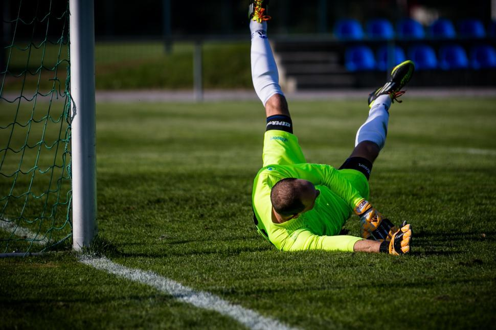 Download Free Stock Photo of Soccer goalkeeper stretching to stop the ball
