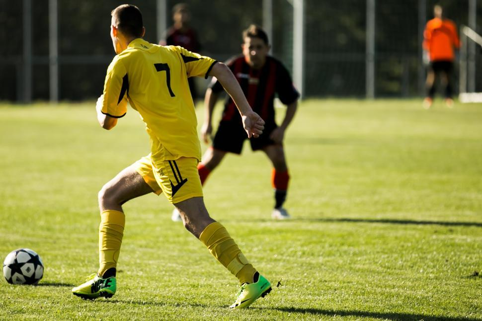 Download Free Stock Photo of Soccer players playing on the field during a match
