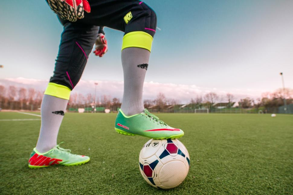 Download Free Stock Photo of Footballer standing on football