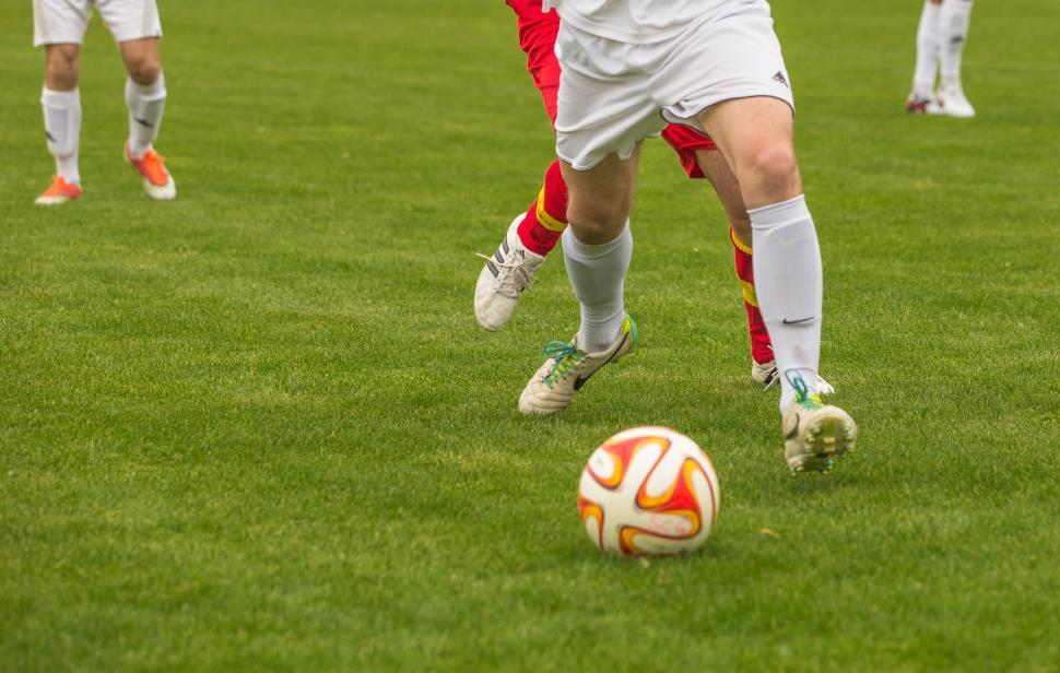 Download Free Stock Photo of Footballers pushing each other for ball