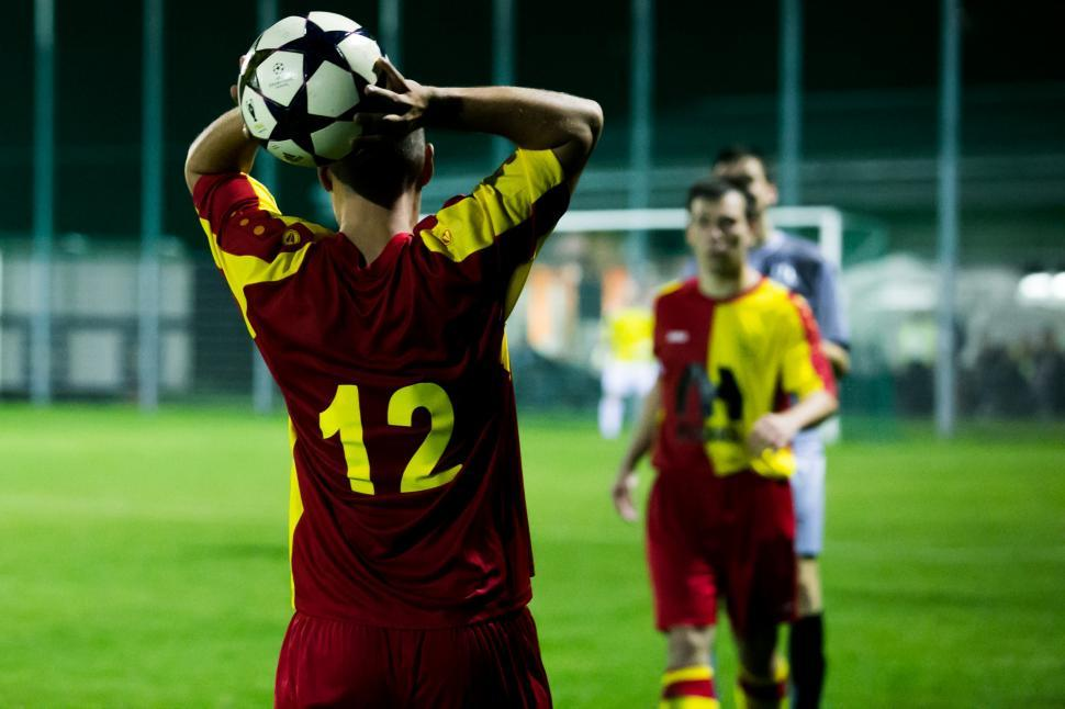 Download Free Stock Photo of Football player taking a throw-in