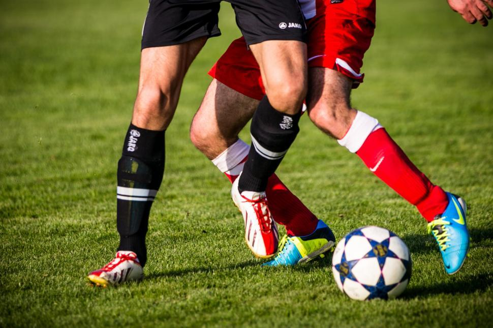 Download Free Stock HD Photo of Soccer players pushing each other for a ball Online