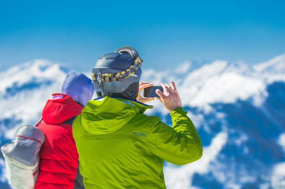 Download Free Stock HD Photo of Mountaineers taking photos with mobile phone Online