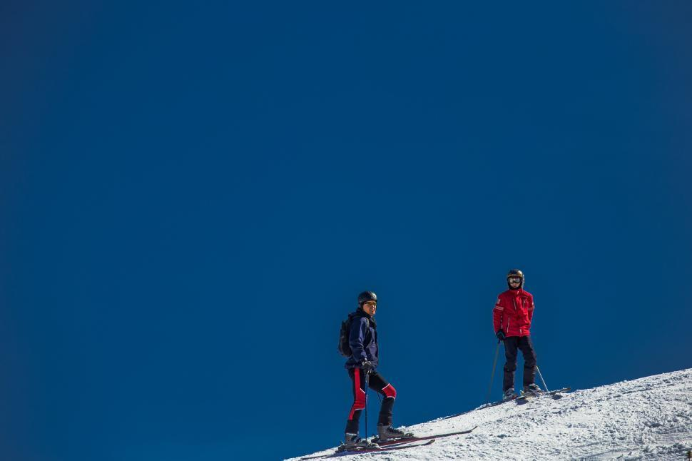 Download Free Stock Photo of Two Skiers on ski runway