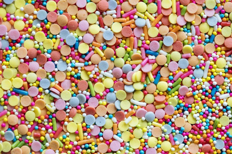 Download Free Stock Photo of Flat lay of rainbow sparkle candy background