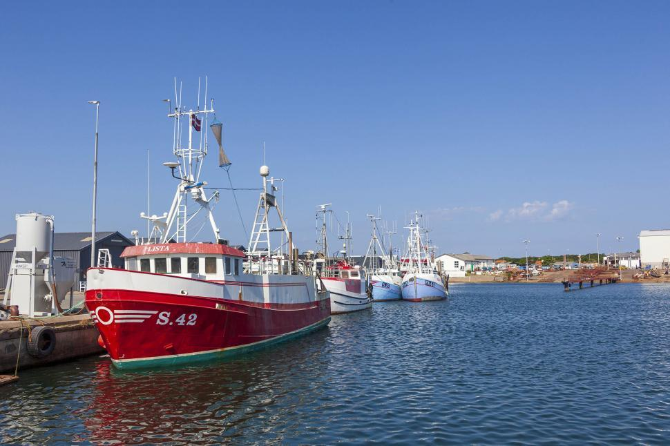 Download Free Stock HD Photo of Fishing vessels moored at a dock Online