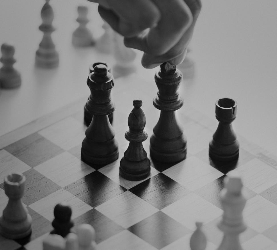 Download Free Stock HD Photo of Close up of a person s hand moving a chess piece  Online