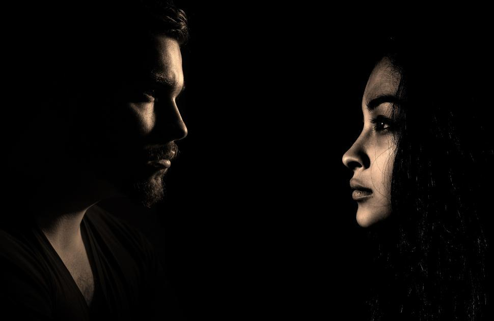 Download Free Stock Photo of Profile Dark View of Man and Woman - Face to Face