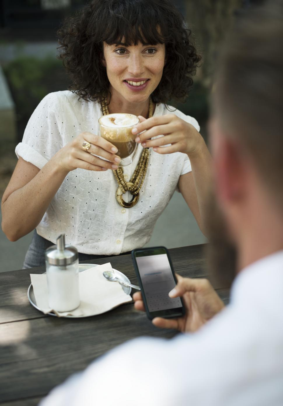 Download Free Stock Photo of Close up of two people having a discussion at an outdoor restaurant table
