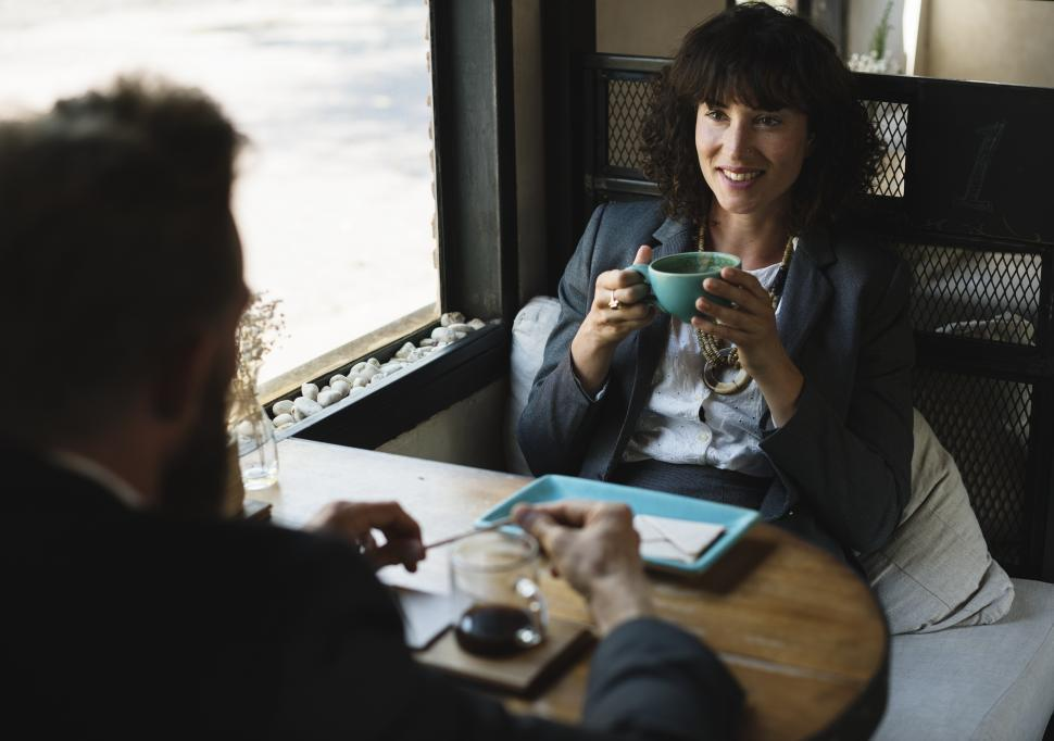 Download Free Stock Photo of Two business people discussing business maybe at a restaurant table