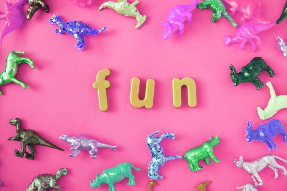 Download Free Stock HD Photo of Text - fun surrounded with colorful toy animals on pink surface Online