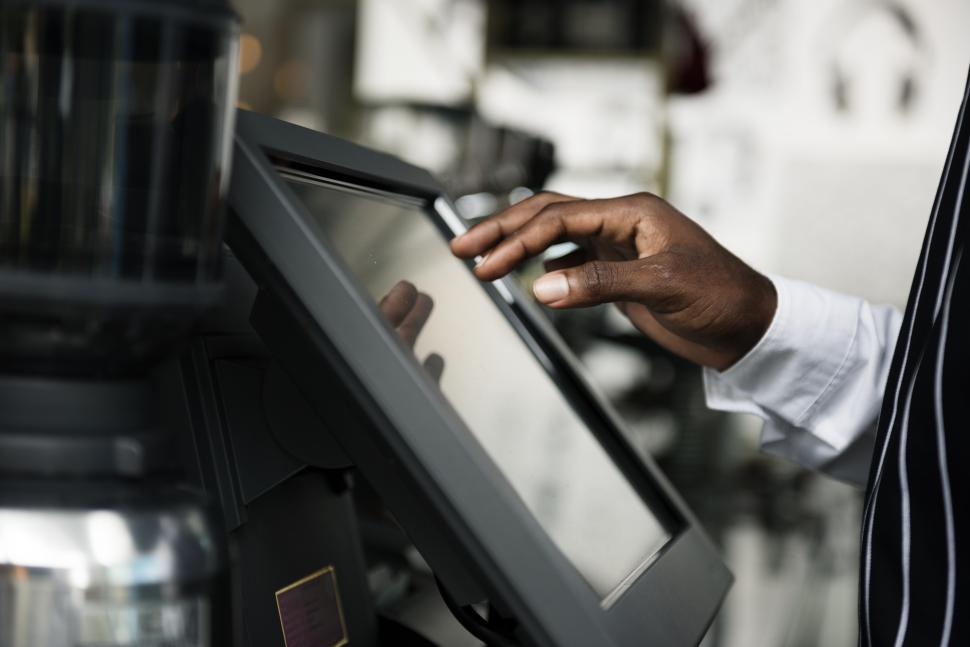 Download Free Stock Photo of A cafe waiter s hand taking order on the kiosk touch screen