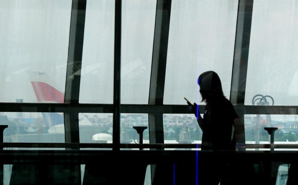 Download Free Stock Photo of Silhouette of Airport Passenger