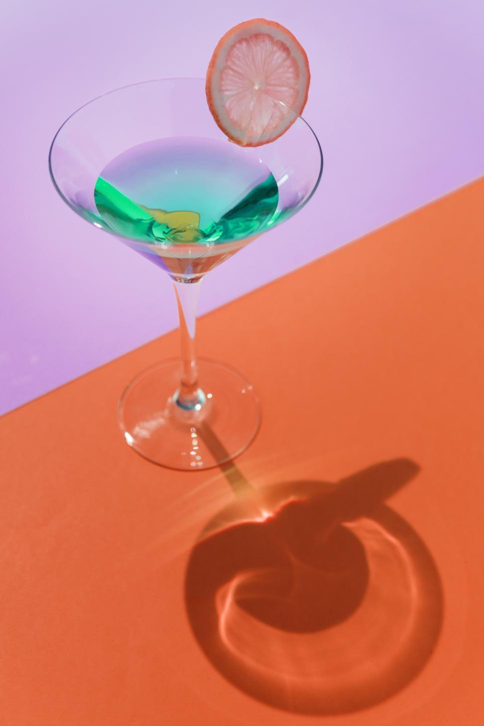 Download Free Stock Photo of Close up of a glass of martini on colorful background