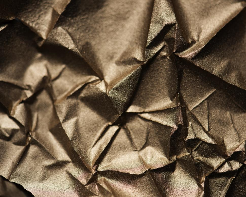 Download Free Stock Photo of Abstract texture of wrinkled golden paper