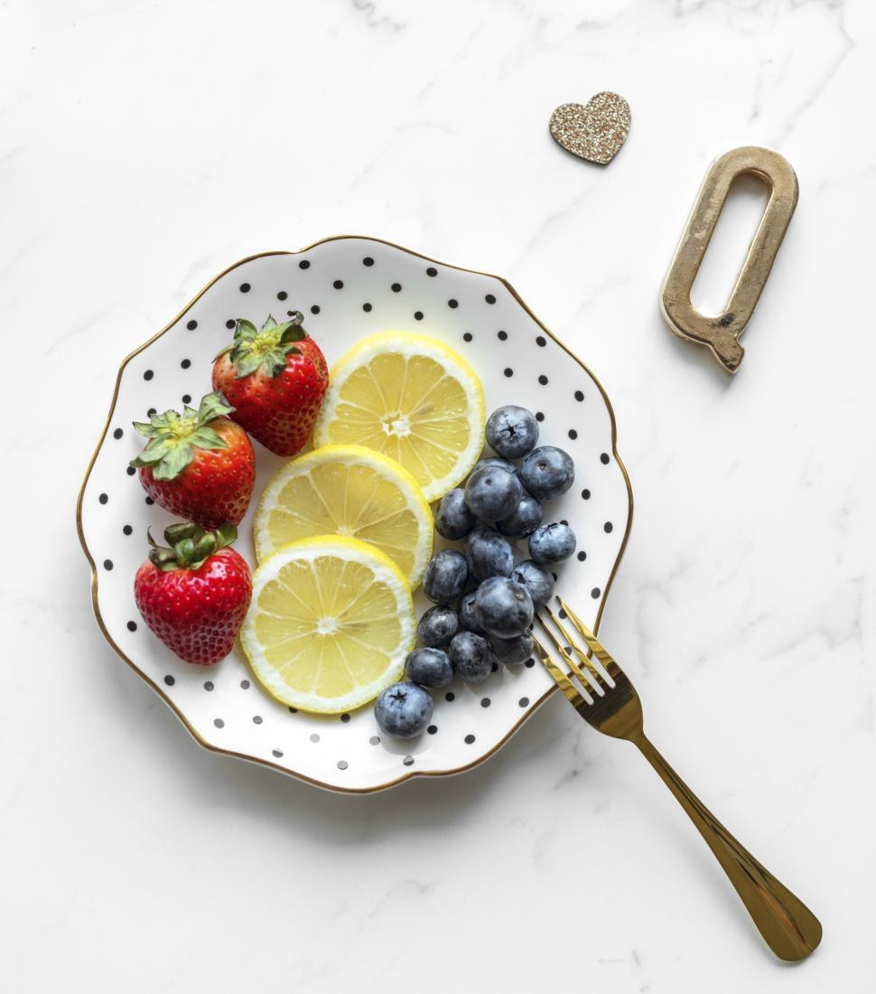Download Free Stock Photo of Flat lay of fruit arranged on a plate