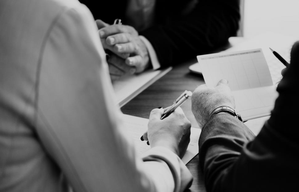 Download Free Stock HD Photo of Black and white close up of businesspeople in a meeting Online