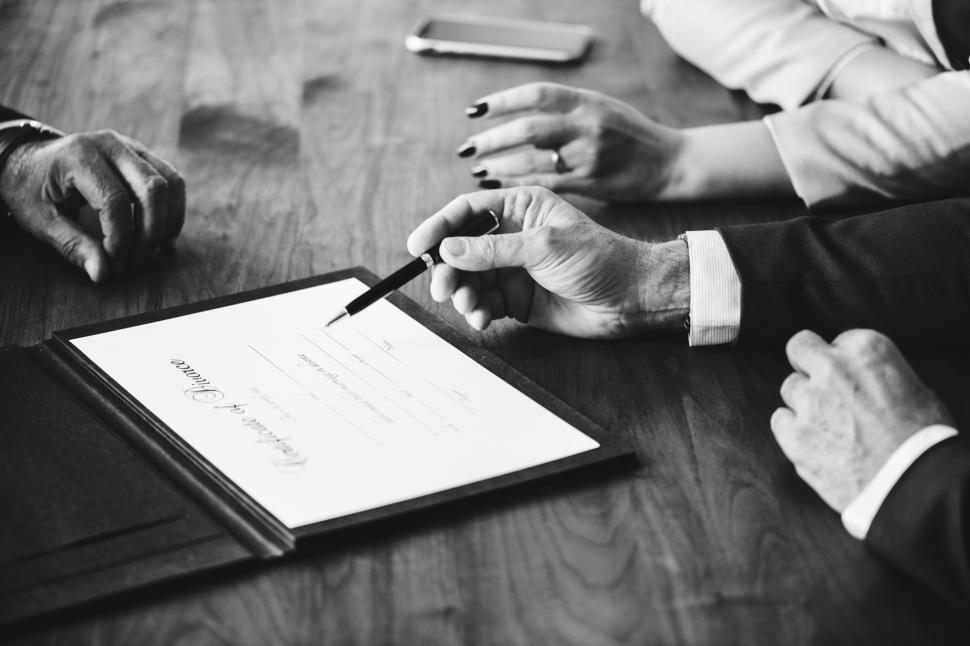 Download Free Stock HD Photo of Black and white photo of hand signing on the divorce certificate Online