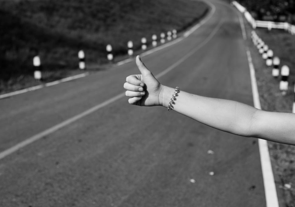 Download Free Stock HD Photo of A hand with thumbs up gesture asking permission for a lift - Hitchhiking Online