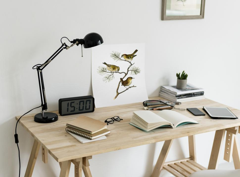 Download Free Stock HD Photo of Close up of a picture and books on a study table Online