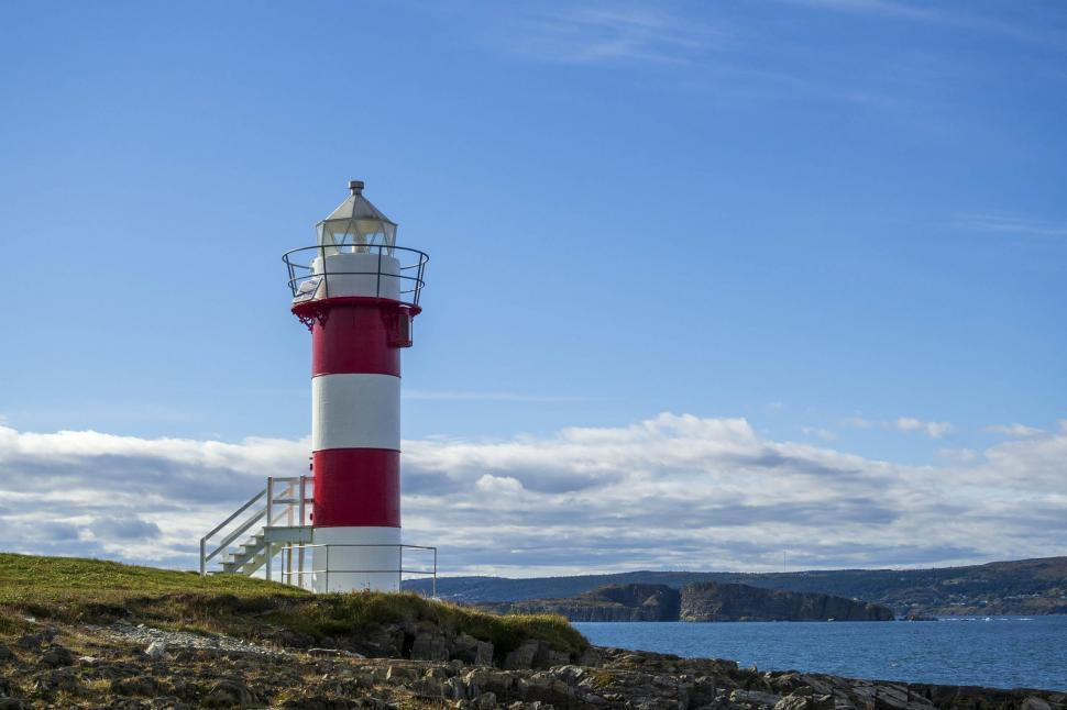 Download Free Stock HD Photo of Light tower along coastline Online