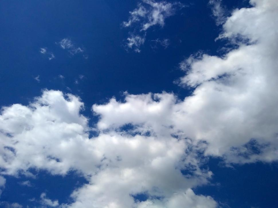 Download Free Stock HD Photo of Bright blue sky with white fluffy clouds  Online