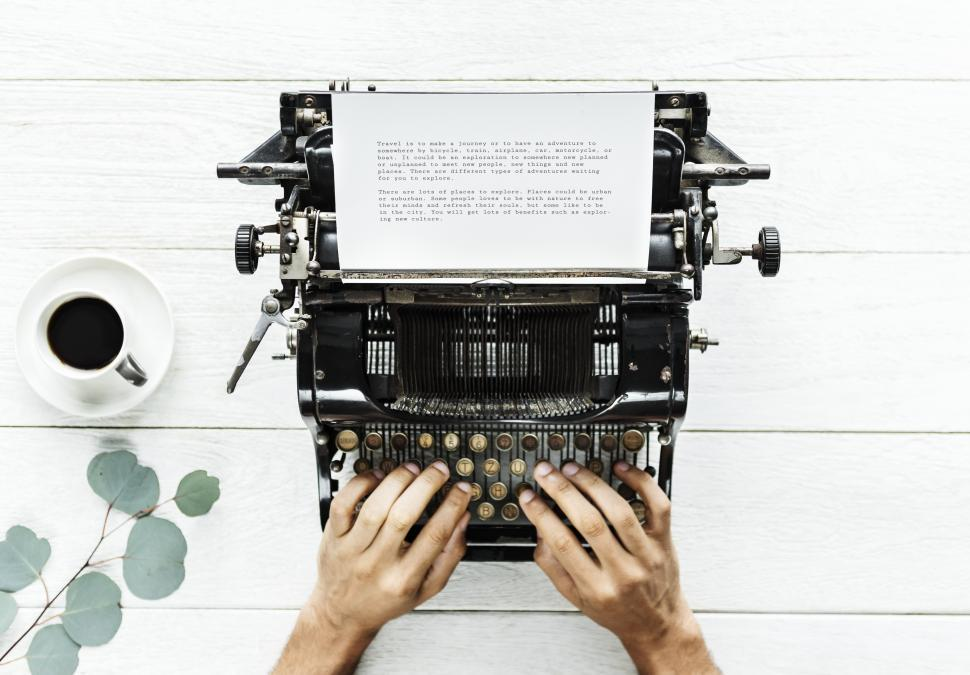 Download Free Stock Photo of Overhead view of letter emerging from a vintage typewriter