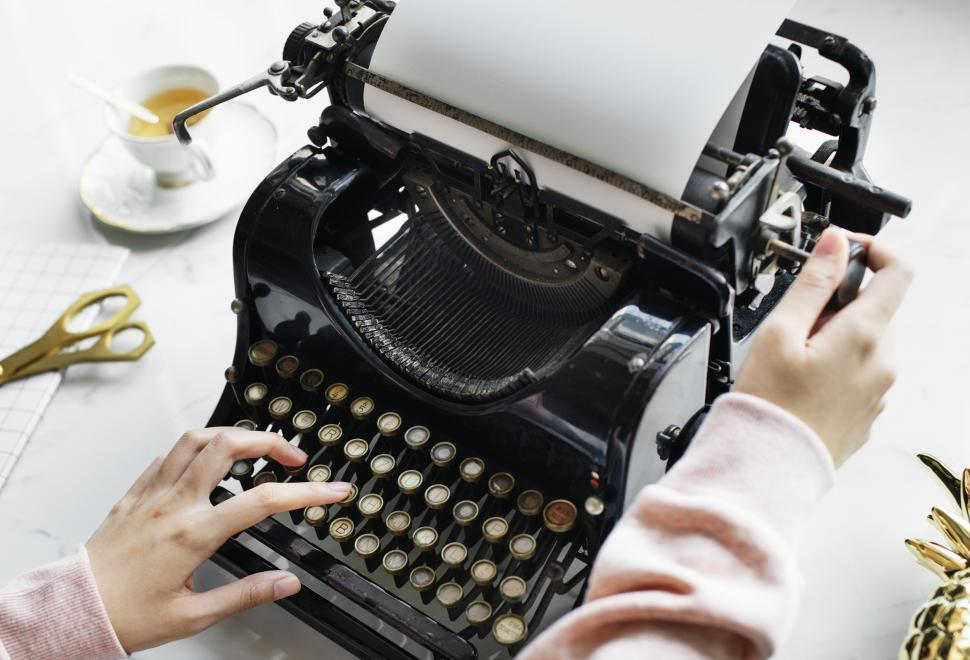 Download Free Stock Photo of Close up of a vintage typewriter s platen being rotated by a hand