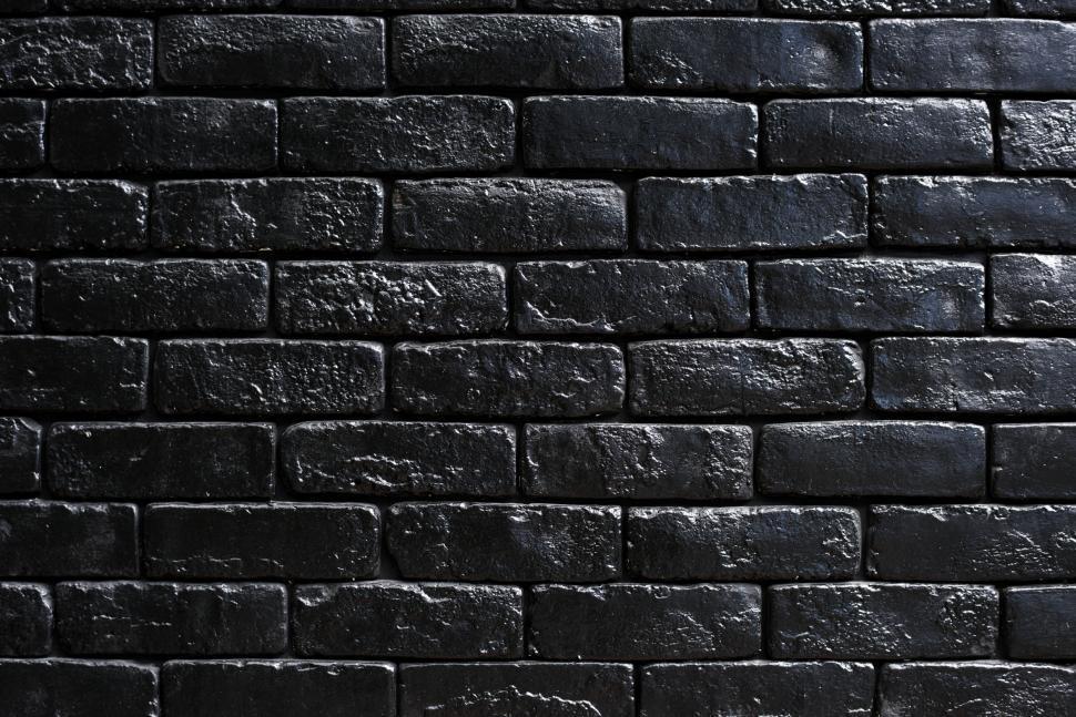 Download Free Stock Photo of Close up of a dark brick wall - black bricks