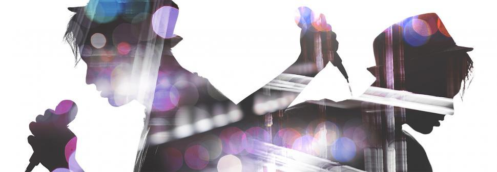 Download Free Stock HD Photo of Silhouette of two singers masking concert background Online