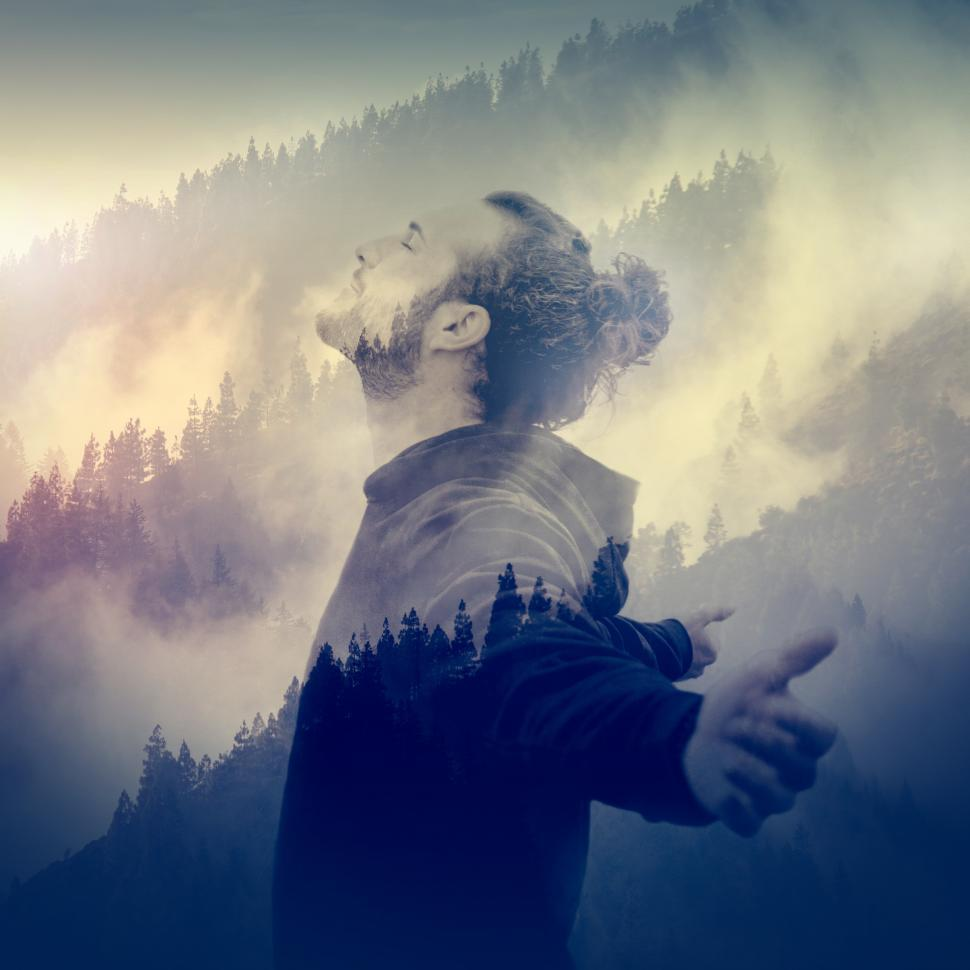 Download Free Stock Photo of In Communion with Nature - Man Breeding Fresh Air Over Foggy Lan