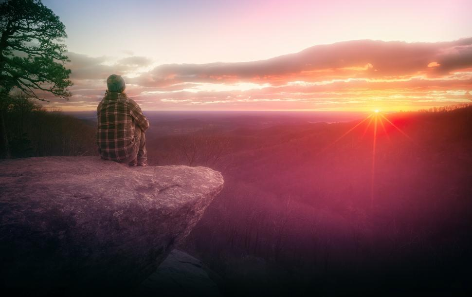 Download Free Stock Photo of Hiker Watching the Sunrise on Rock Ledge