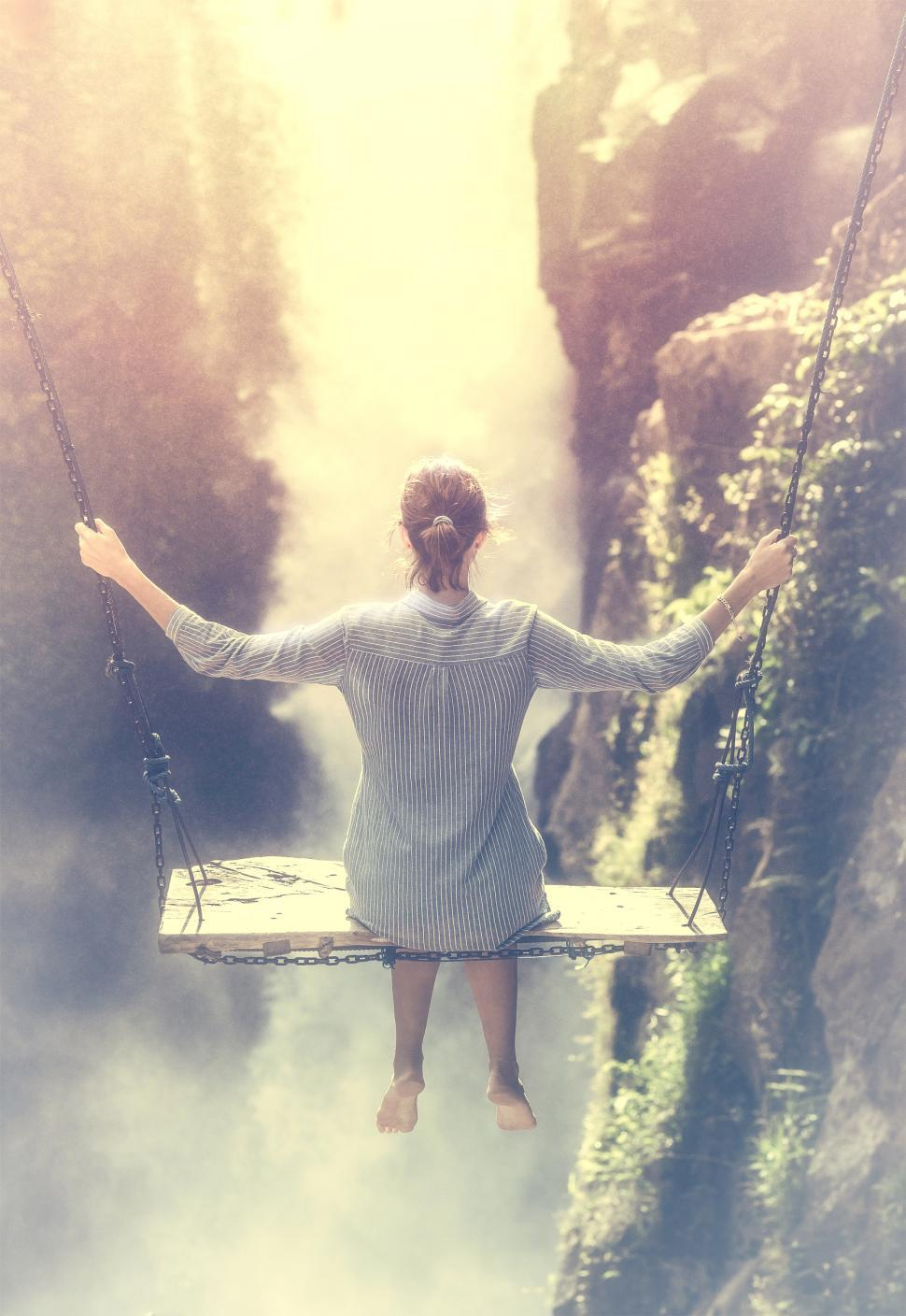 Download Free Stock Photo of Young Woman on a Swing in Front of Waterfall