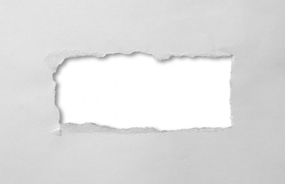 Download Free Stock Photo of A hole torn through paper