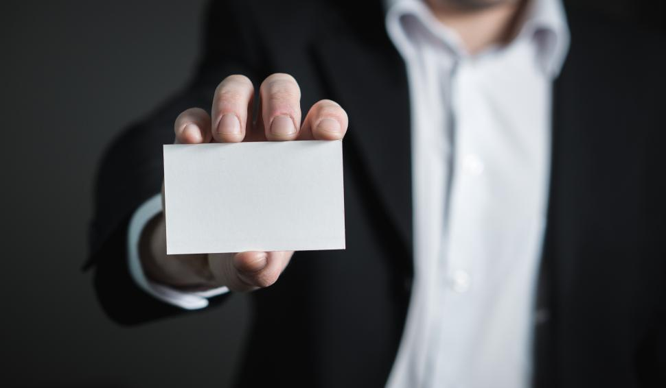 Download Free Stock Photo of Close up of a hand holding a business card