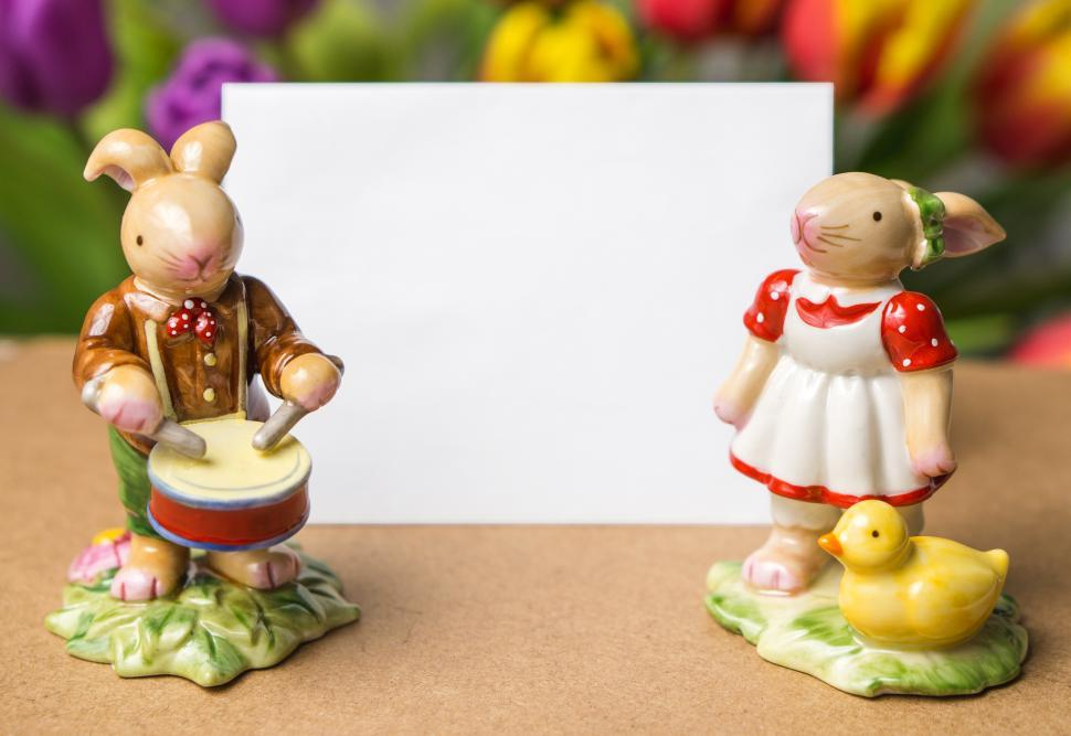 Download Free Stock HD Photo of Close up of ceramic Easter bunny rabbit toys with blank card Online