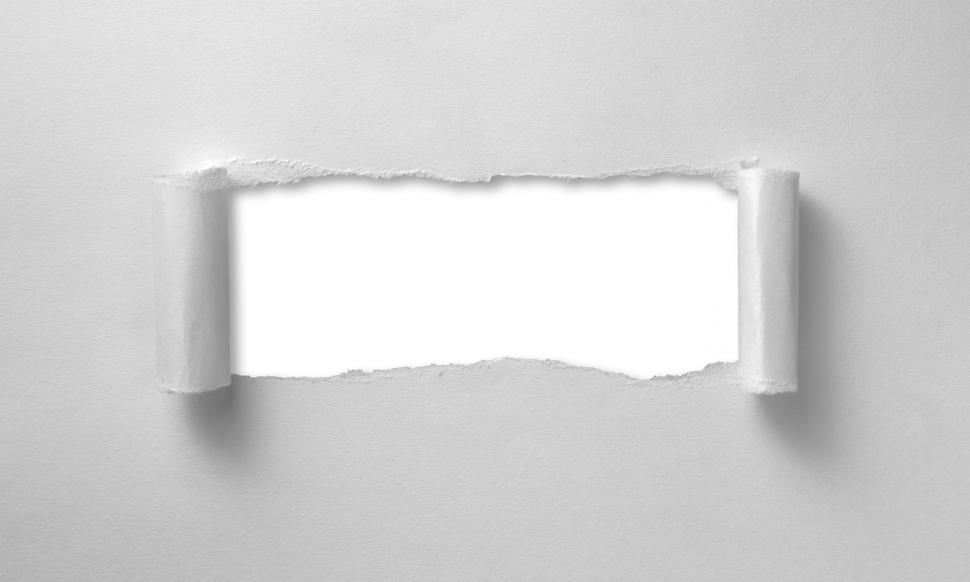 Download Free Stock Photo of A hole ripped through paper sheet - curled edges