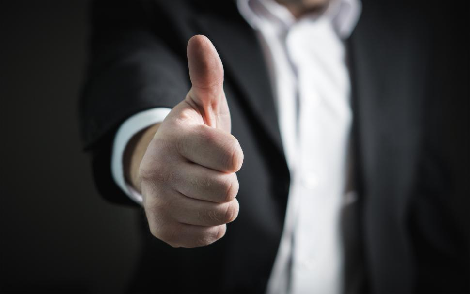Download Free Stock HD Photo of A business person showing thumbs up sign Online