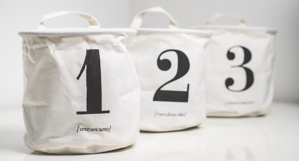 Download Free Stock HD Photo of Close up of three numbered bags Online
